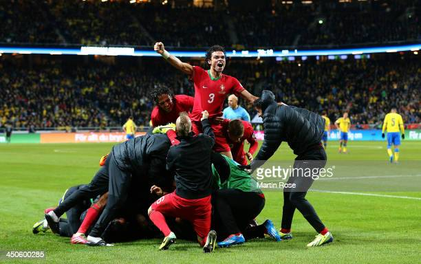 Pepe of Portugal celebrates their 3rd goal during the FIFA 2014 World Cup Qualifier Playoff Second Leg match between Sweden and Portugal at Friends...