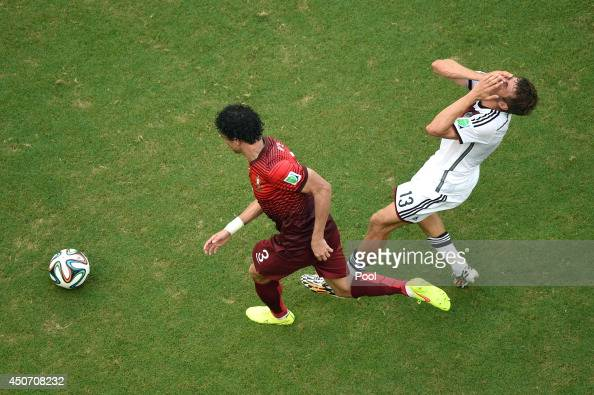 Pepe of Portugal fouls Thomas Mueller of Germany during the 2014 FIFA World Cup Brazil Group G match between Germany and Portugal at Arena Fonte Nova...