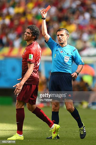 Pepe of Portugal is shown a red card and sent off by referee Milorad Mazic during the 2014 FIFA World Cup Brazil Group G match between Germany and...