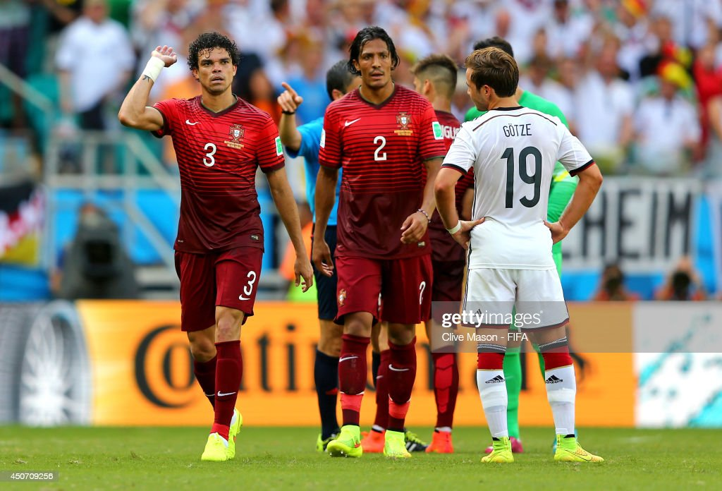 Pepe of Portugal (L) reacts after he was sent off by referee Milorad Mazic during the 2014 FIFA World Cup Brazil Group G match between Germany and Portugal at Arena Fonte Nova on June 16, 2014 in Salvador, Brazil.
