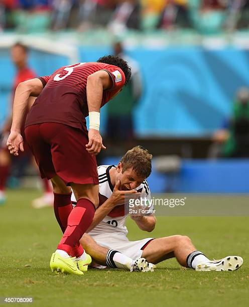 Pepe of Portugal reacts angrily toward Thomas Mueller of Germany resulting in a red card during the 2014 FIFA World Cup Brazil Group G match between...