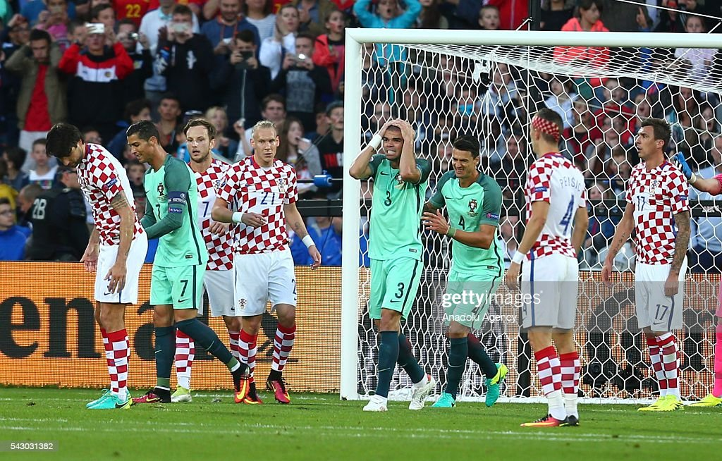 Pepe (4th R) of Portugal reacts during the Euro 2016 round of 16 football match between Croatia and Portugal at Stade Bollaert-Delelis in Lens, France on June 25, 2016.