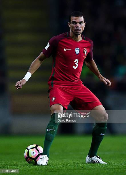 Pepe of Portugal runs with the ball during the FIFA 2018 World Cup Qualifier between Portugal and Andorra at Estadio Municipal de Aveiro on October 7...
