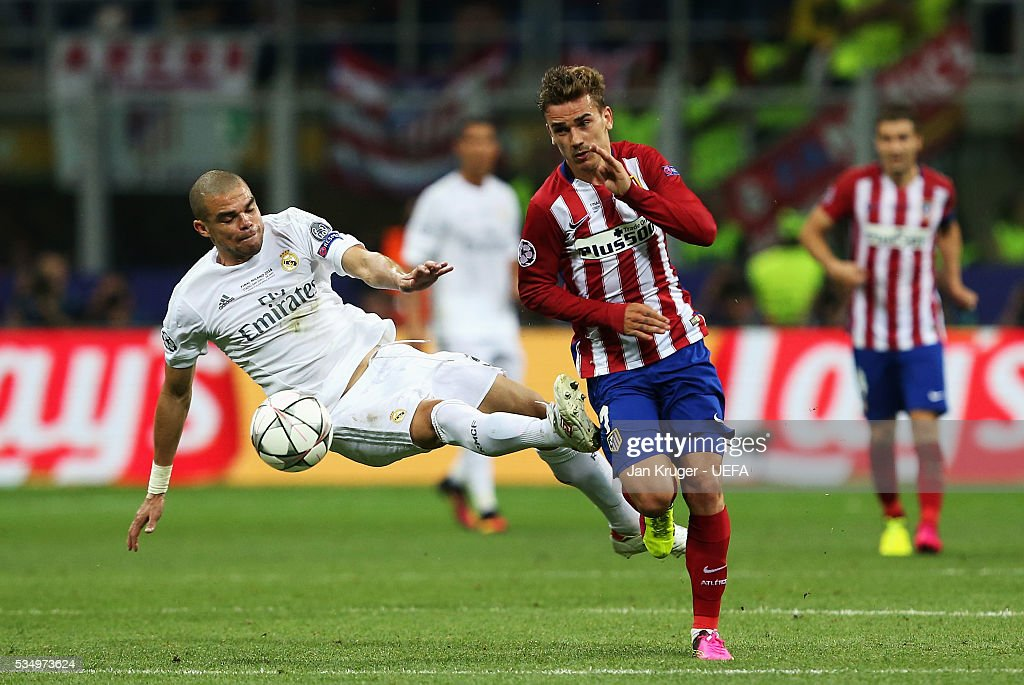 <a gi-track='captionPersonalityLinkClicked' href=/galleries/search?phrase=Pepe+-+Joueur+de+football+portugais&family=editorial&specificpeople=4401229 ng-click='$event.stopPropagation()'>Pepe</a> of Real Madrid and <a gi-track='captionPersonalityLinkClicked' href=/galleries/search?phrase=Antoine+Griezmann&family=editorial&specificpeople=7197539 ng-click='$event.stopPropagation()'>Antoine Griezmann</a> of Atletico Madrid compete for the ball during the UEFA Champions League Final between Real Madrid and Club Atletico de Madrid at Stadio Giuseppe Meazza on May 28, 2016 in Milan, Italy.