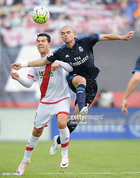 Pepe of Real Madrid battles for the ball against Nicolas Ladislao ����Miku���� of Rayo Vallecano de Madrid during the La Liga match between Rayo...