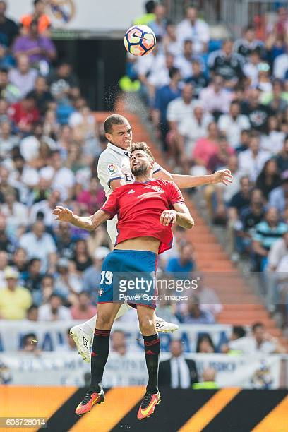 Pepe of Real Madrid battles for the ball with Kenan Kodro of Osasuna during the La Liga match between Real Madrid and Osasuna at the Santiago...