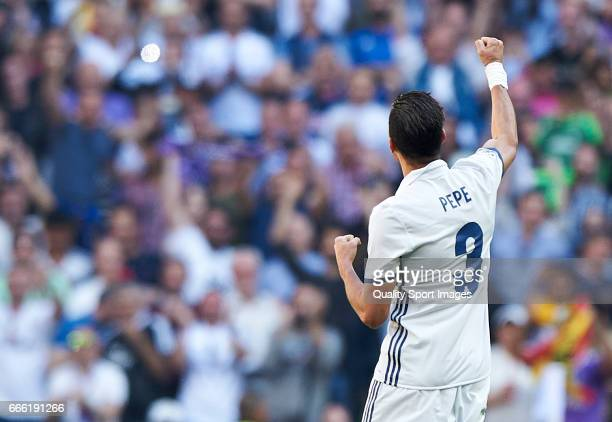 Pepe of Real Madrid celebrates after scoring a goal during the La Liga match between Real Madrid CF and Atletico de Madrid at Estadio Santiago...