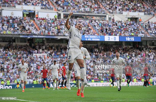 Pepe of Real Madrid celebrates after scoring Real's 4th goal during the La Liga match between Real Madrid CF and CA Osasuna at Estadio Santiago...