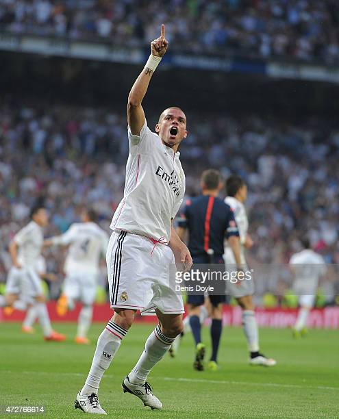 Pepe of Real Madrid celebrates after scoring Real's opening goal during the La Liga match between Real Madrid CF and Valencia CF at Estadio Santiago...