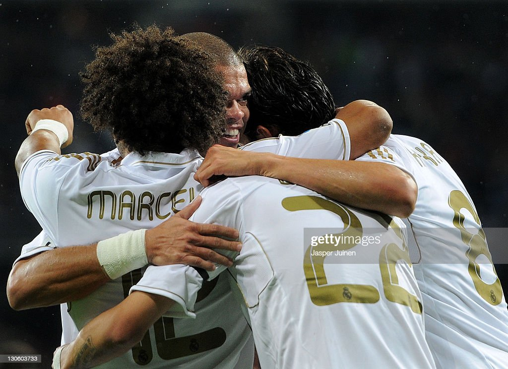 Pepe (2nd L) of Real Madrid celebrates Angel Di Maria's goal with their teammates Marcelo (L) and Kaka (R) during the la Liga match between Real Madrid and Villarreal at the Estadio Santiago Bernabeu on October 26, 2011 in Madrid, Spain.