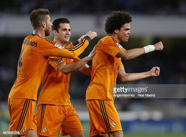 Pepe of Real Madrid celebrates with Sergio Ramos and Nacho Fernandez after scoring their team's third goal during the La Liga match between Real...