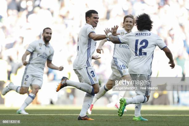 Pepe of Real Madrid celebrates with team mates after scoring the opening goal during the La Liga match between Real Madrid and Club Atletico de...