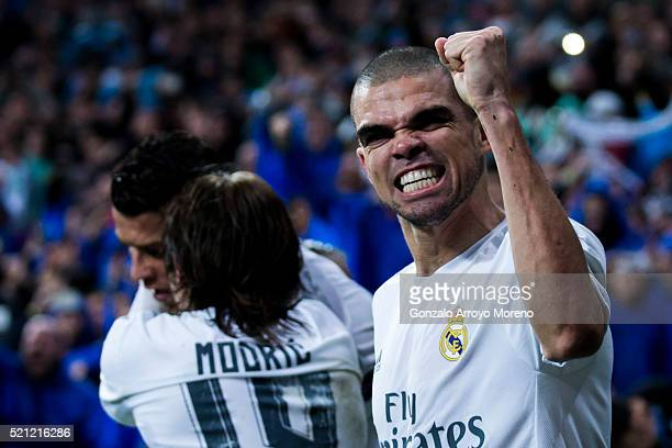 Pepe of Real Madrid CF celebrates his teammate Cristiano Ronaldo's third goal during the UEFA Champions League quarter final second leg match between...