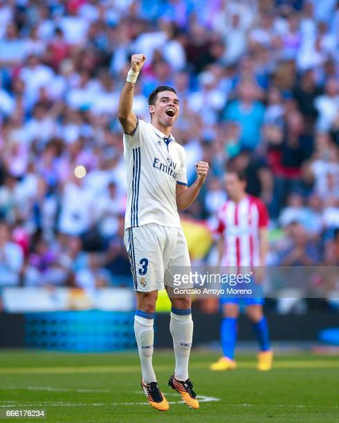 Pepe of Real Madrid CF celebrates scoring their opening goal during the La Liga match between Real Madrid CF and Club Atletico de Madrid at Estadio...