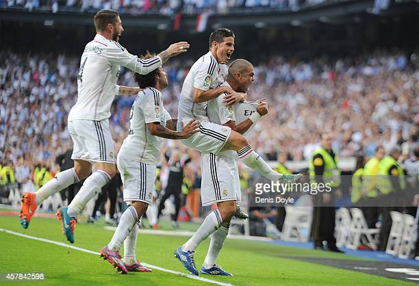 Pepe of Real Madrid CF celebrates with James Rodriguez after scoring his team's 2nd goal from the penalty spot during the La Liga match between Real...