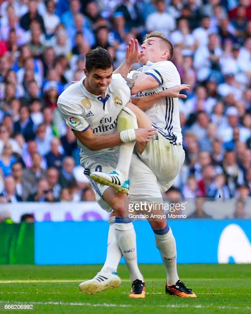 Pepe of Real Madrid CF clashes with his teammate Toni Kroos during the La Liga match between Real Madrid CF and Club Atletico de Madrid at Estadio...