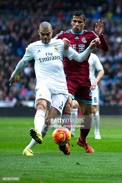 Pepe of Real Madrid CF competes for the ball with Jonathas Cristian of Real Sociedad de Futbol during the La Liga match between Real Madrid CF and...