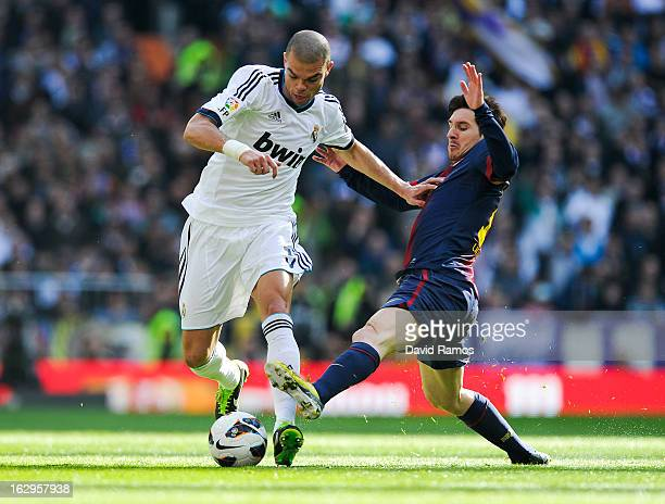 Pepe of Real Madrid CF duels for the ball with Lionel Messi of FC Barcelona during the La Liga match between Real Madrid CF and FC Barcelona at...