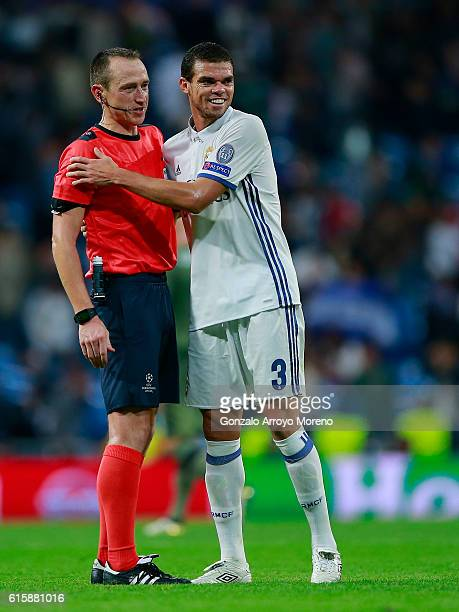 Pepe of Real Madrid CF embraces a match official after the UEFA Champions League group F match between Real Madrid CF and Legia Warszawa at Santiago...