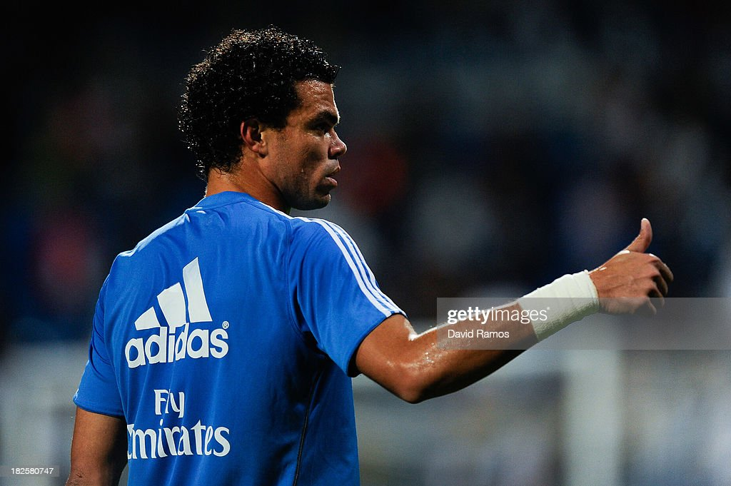 Pepe of Real Madrid CF gives his thumbs up during the warm up prior to the La Liga match between Real Madrid CF and Club Atletico de Madrid at Bernabeu on September 28, 2013 in Madrid, Spain.