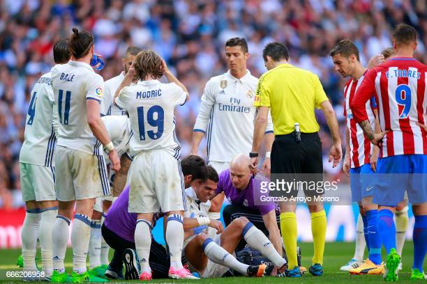 Pepe of Real Madrid CF grimmaces in pain after clashing with his teammate Toni Kroos during the La Liga match between Real Madrid CF and Club...