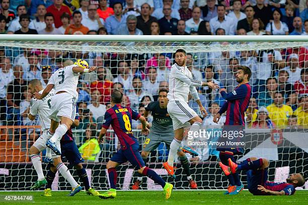 Pepe of Real Madrid CF heads in their second goal during the La Liga match between Real Madrid CF and FC Barcelona at Estadio Santiago Bernabeu on...