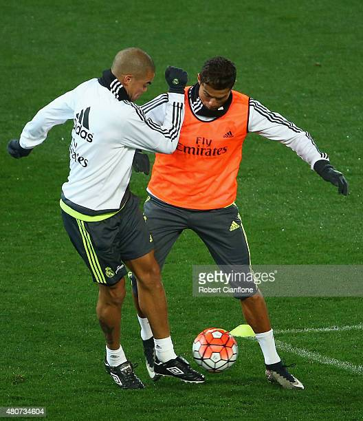 Pepe of Real Madrid challenges Cristiano Ronaldo during Real Madrid training session at Melbourne Cricket Ground on July 15 2015 in Melbourne...
