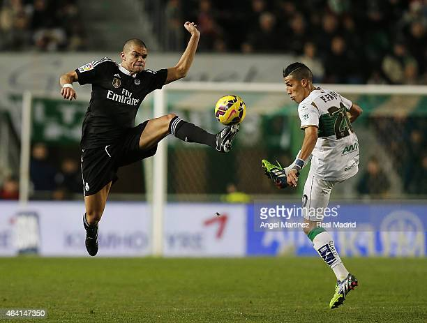 Pepe of Real Madrid competes for the ball with Faycal Fajr of Elche FC during the La Liga match between Elche FC and Real Madrid CF at Estadio Manuel...