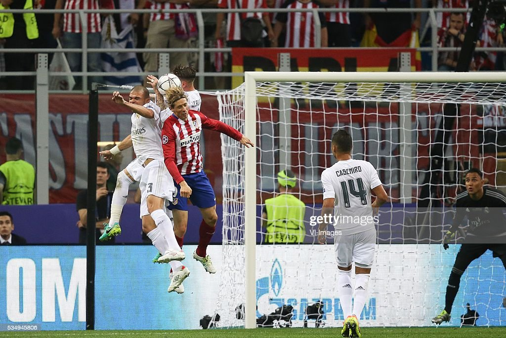 Pepe of Real Madrid, Fernando Torres of Club Atletico de Madrid, Casemiro of Real Madrid, goalkeeper Keylor Navas of Real Madrid during the UEFA Champions League final match between Real Madrid and Atletico Madrid on May 28, 2016 at the Giuseppe Meazza San Siro stadium in Milan, Italy.