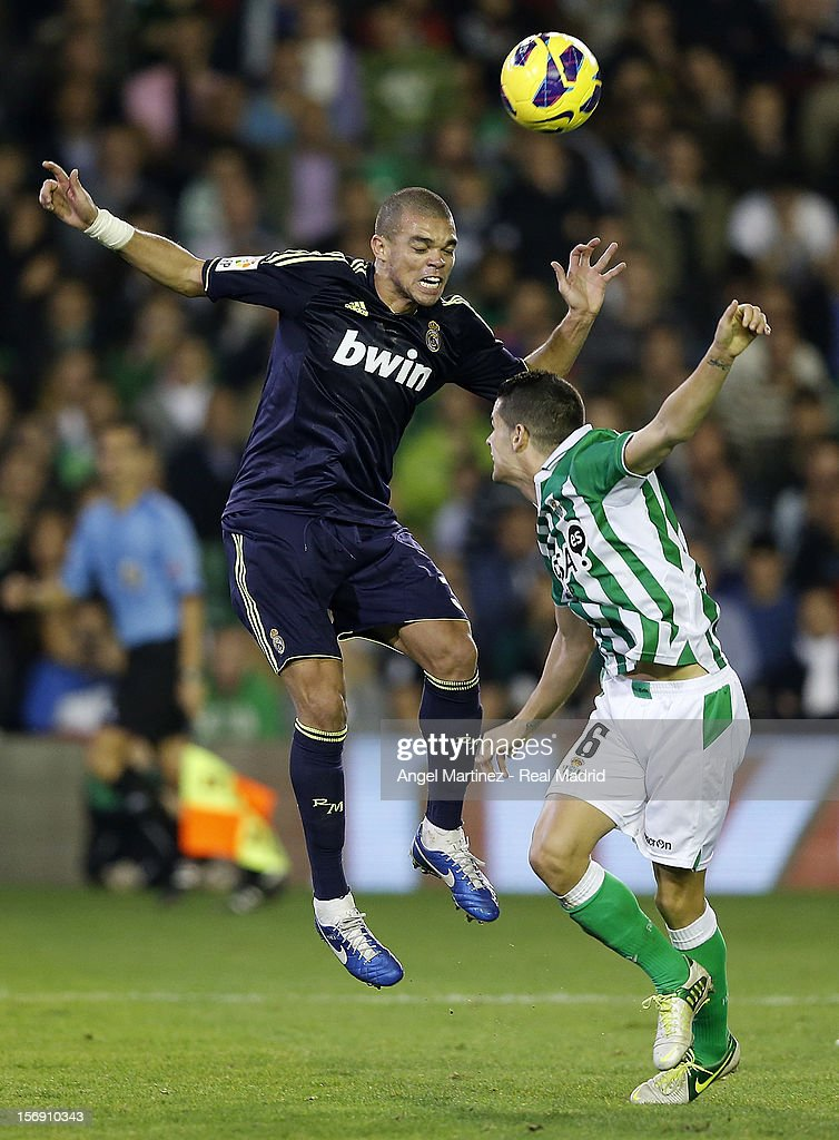Pepe of Real Madrid heads the ball against Alex Martinez of Real Betis during the La Liga match between Real Betis Balompie and Real Madrid CF at Estadio Benito Villamarin on November 24, 2012 in Seville, Spain.