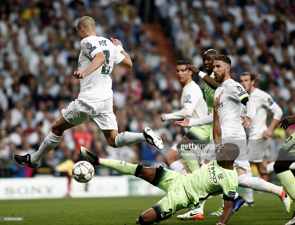 Pepe (L) of Real Madrid in action against Fernandinho of Manchester City during the UEFA Champions League semi-final second leg football match between Real Madrid and Manchester City at the Santiago Bernabeu Stadium in Madrid, Spain on May 4, 2016.