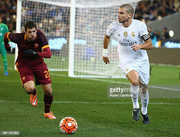 Pepe of Real Madrid is pressured by Mattia Destro of AS Roma during the International Champions Cup friendly match between Real Madrid and AS Roma at...