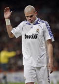 Pepe of Real Madrid reacts as he trudges off the pitch after receiving a red card during the UEFA Champions League first knockout round second leg...