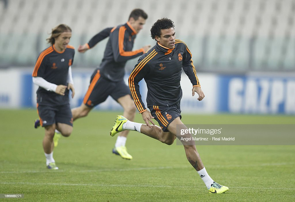 Pepe of Real Madrid runs during a training session ahead of their UEFA Champions League Group B match against Juventus at Juventus Arena on November 4, 2013 in Turin, Italy.