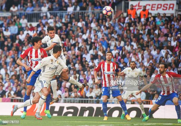 Pepe of Real Madrid scores Real's opening goal during the La Liga match between Real Madrid CF and Club Atletico de Madrid at Bernabeu on April 8...
