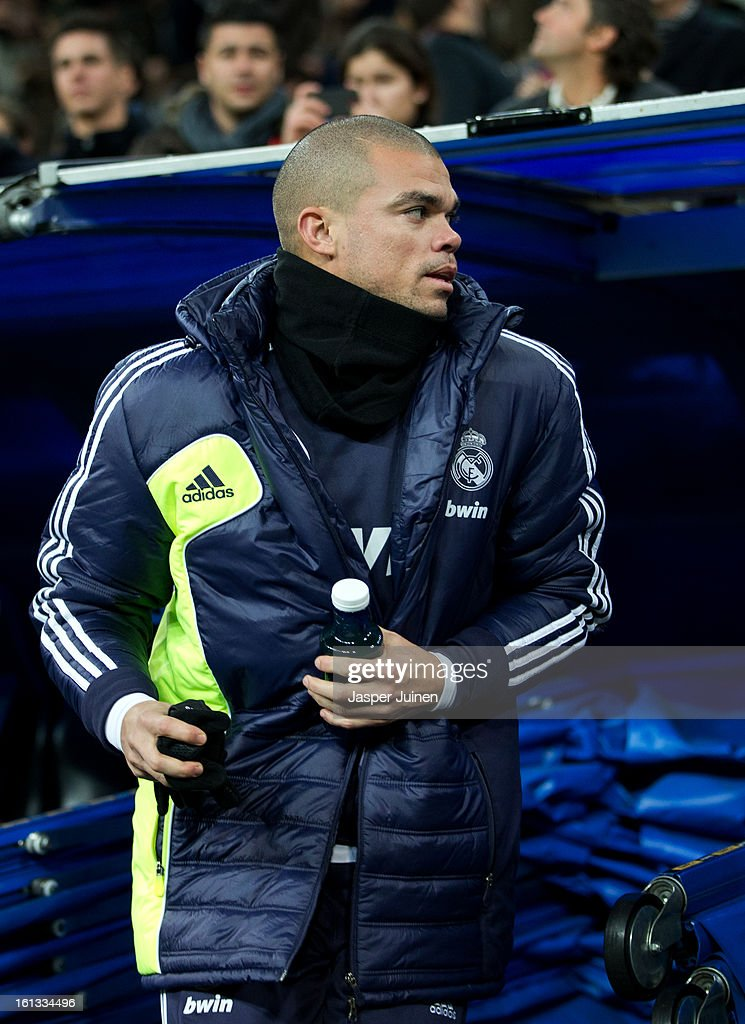 Pepe of Real Madrid takes his place on the bench prior to the start of the la Liga match between Real Madrid CF and Sevilla FC at Estadio Santiago Bernabeu on February 9, 2013 in Madrid, Spain.