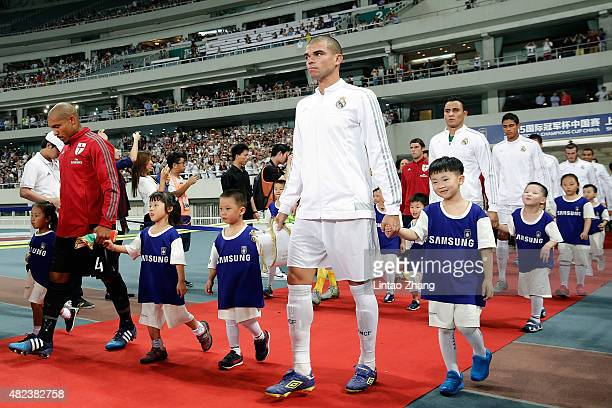 Pepe of Real Madrid walks on to the pitch before during the International Champions Cup match between Real Madrid and AC Milan at Shanghai Stadium on...