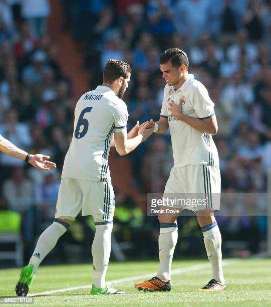 Pepe of Real Madridis consoled by Nacho after coming off injured during the La Liga match between Real Madrid CF and Club Atletico de Madrid at...