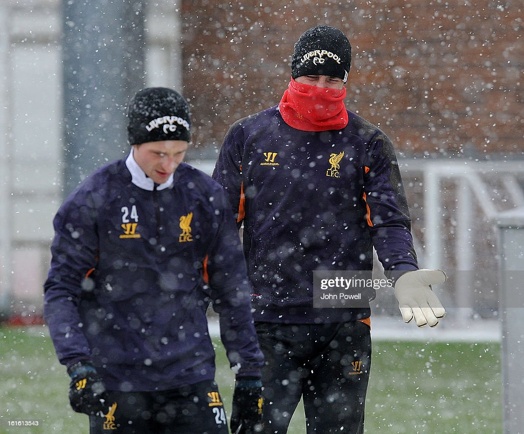 Pepe Reina and Joe Allen of Liverpool in action during a training session at Melwood Training Ground on February 13, 2013 in Liverpool, England.