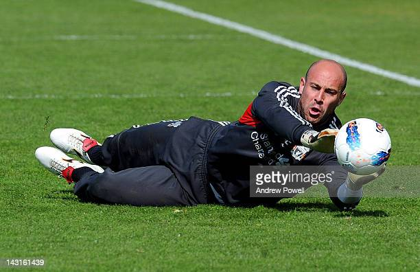 Pepe Reina of Liverpool in action during a training session at Melwood Training Ground on April 20 2012 in Liverpool England