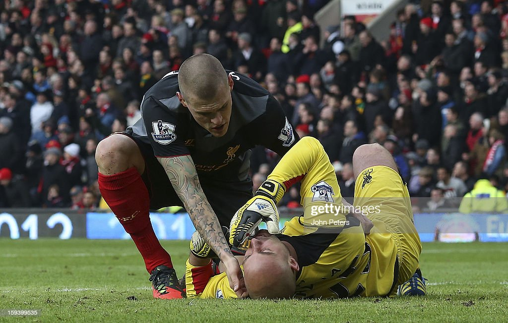 Pepe Reina of Liverpool lies injured during the Barclays Premier League match between Manchester United and Liverpool at Old Trafford on January 13, 2013 in Manchester, England.