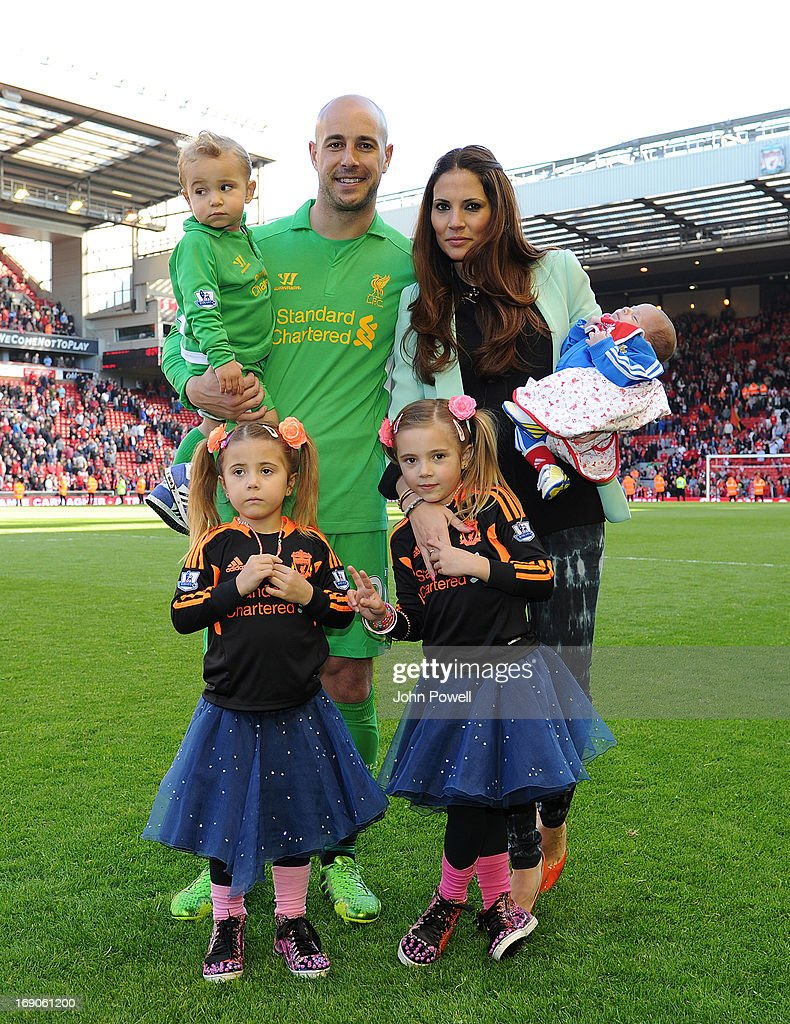 Pepe Reina of Liverpool poses with his family at the end of the Barclays Premier League match between Liverpool and Queens Park Rangers at Anfield on May 19, 2013 in Liverpool England.