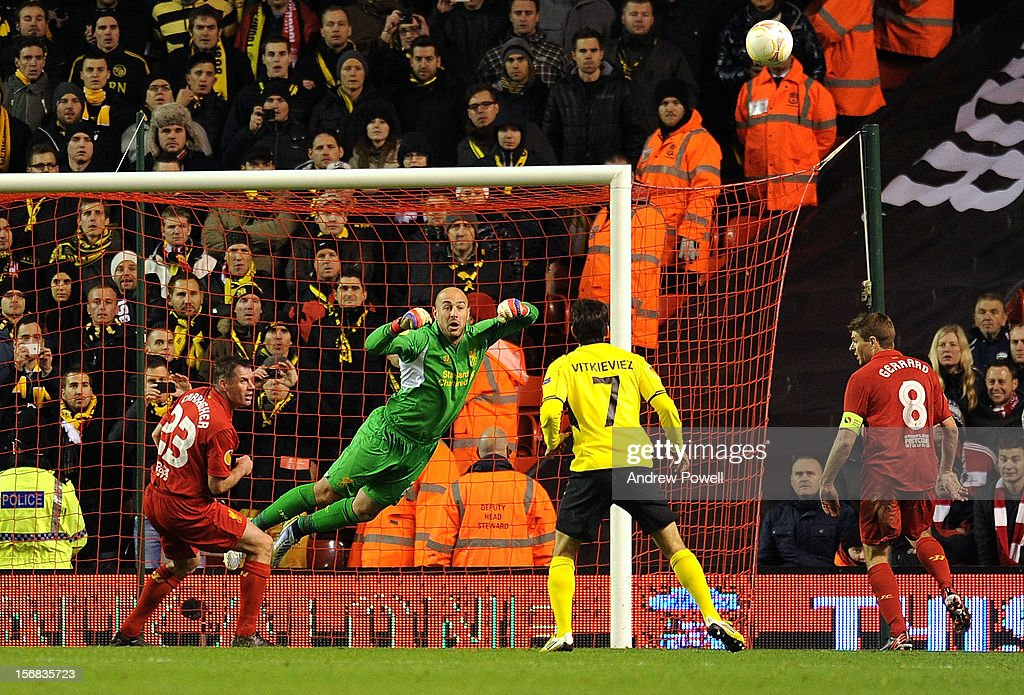 Pepe Reina of Liverpool punches the ball clear during the UEFA Europa League Group A match between Liverpool and BSC Young Boys at Anfield on November 22, 2012 in Liverpool, England.
