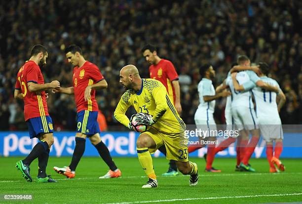 Pepe Reina of Spain looks dejected as Adam Lallana of England scores their first goal from the penalty spot during the international friendly match...