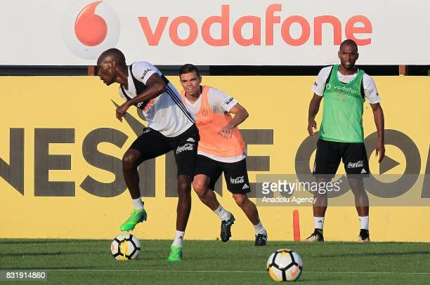 Pepe Ryan Babel and Atiba Hutchinson of Besiktas attend a training session ahead of a Turkish Spor Toto Super Lig match between Kasimpasa and...