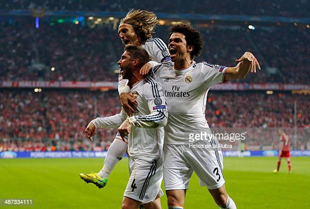 Pepe Sergio Ramos and Luca Modric of Real Madrid celebrate after scoring during the UEFA Champions League Semi Final second leg match between FC...