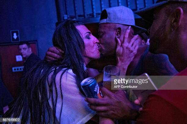 MC Pepita kisses a fan after performing at a LGBT nightclub in downtown Rio de Janeiro Brazil on July 30 2017 Rap and funk music is overturning...