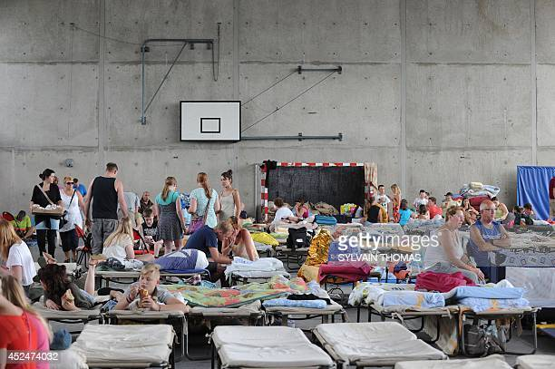 Peple gather at the gymnasium in BourgSaintAndeol where around 200 campers slept last night after being evacuated from a camping ground in SaintJust...