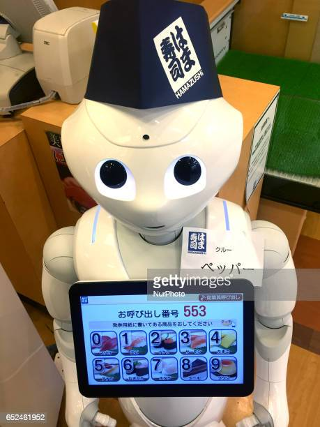 Pepper a humanoid robot developed by SoftBank Group Corp moves around on its own to guide passengers at sushi shop in Tokyo Japan March 12 2017