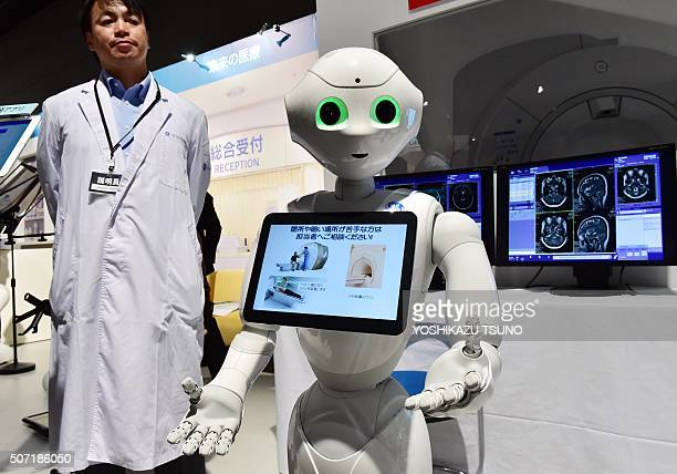 'Pepper' a humanoid robot from Japan's telecommunication giant Softbank 'help' a hospital patient by explaining procedures for MRI machines during a...